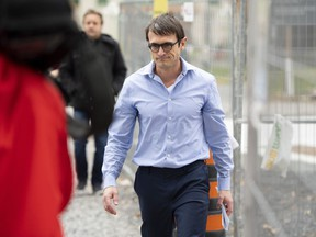 Cameron Ortis, a senior intelligence official at the RCMP, leaves the courthouse in Ottawa after being granted bail on October 22, 2019. Federal prosecutors are signalling they want to move the national-secrets case against a senior RCMP official behind closed doors -- at least temporarily -- while a key issue is sorted out. Prosecutor Judy Kliewer says the Crown intends to ask that the public and media be excluded from a March 17 pre-trial hearing, contrary to the open-court principle, in the case of Cameron Jay Ortis.