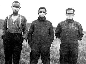 Three prairie farmers wear masks to ward off the Spanish flu that killed thousands in 1918.