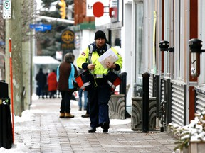 A Canada Post letter carrier on his rounds Tuesday during the COVID-19 pandemic.