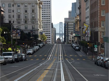 A San Francisco street usually filled with iconic cable cars is mostly empty as millions of residents were ordered to stay home to slow the spread of the deadly coronavirus.