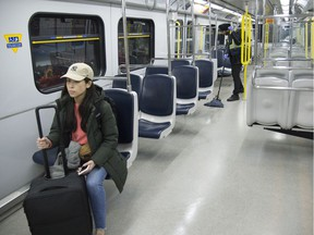 A loan traveller rides the sky train bound for Vancouver International Airport.