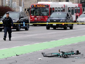 Ottawa Police block off the area where a cyclist was struck on Laurier Avenue near Elgin Street Thursday (May 16, 2019) morning. The driver of the vehicle that has left the cyclist with critical head injuries kept going and then abandoned the vehicle.