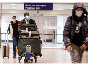 Canadians return from being stranded in Morocco due to flight restrictions imposed to help slow the spread of COVID-19, at Montreal-Trudeau International Airport in Montreal on Monday.