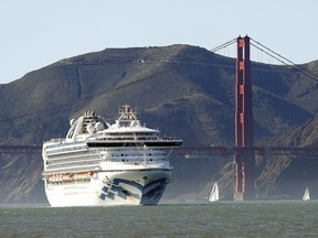 In this Feb. 11, 2020, file photo, the Grand Princess cruise ship passes the Golden Gate Bridge as it arrives from Hawaii in San Francisco. Scrambling to keep the coronavirus at bay, officials ordered the cruise ship to hold off the California coast Thursday, March 5, to await testing of those aboard, after a passenger on an earlier voyage died and at least one other became infected.