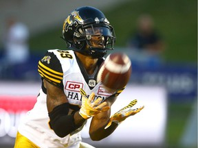 Fieles TiCats Jalen Saunders catches then runs with a kickoff return during CFL action between the Hamilton Tiger Cats and the Calgary Stampeders, Saturday, July 29, 2017.