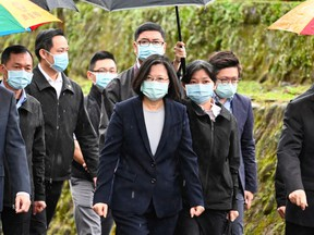 Taiwan President Tsai Ing-wen (centre) has led successful efforts in her country to hold the pandemic at bay.