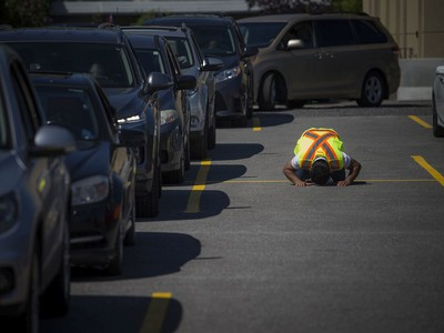 A volunteer prayed during a special drive-in Eid prayer that was held at the Ottawa Mosque on Northwestern Ave, Saturday, May 23, 2020.