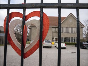 A sign of support hangs on the fence at a long-term care centre in southern Ontario.