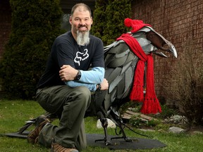 Using two old bathtubs, some car parts and a plow share, Dave Harries has made a huge sculpture he called Crowvid-19.  He invited people to bid on having the sculpture displayed at their home for a week to raise money for the Ottawa Food Bank.