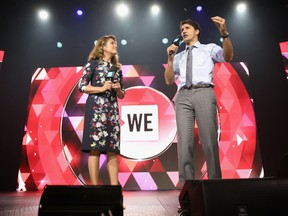 Sophie Grégoire, left, and Prime Minister Justin Trudeau speak on stage at a WE Charity event in New York in 2017.
