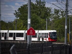 A June file photo of an LRT train making its way along the tracks near Tremblay Station.