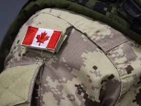 A Canadian flag patch is shown on a soldier's shoulder in Trenton, Ont., on Thursday, Oct. 16, 2014. File photo.