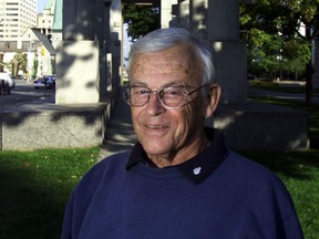 George Wilkes standing in front of the Human Rights Memorial on Elgin Street.