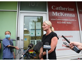 Catherine McKenna speaks to the media about an incident at her constituency office in Ottawa on Monday.