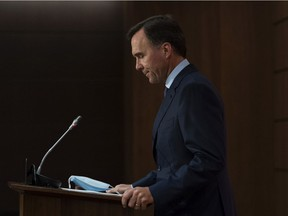 Minister of Finance Bill Morneau announces his resignation during a news conference on Parliament Hill in Ottawa, on Monday, Aug. 17, 2020.