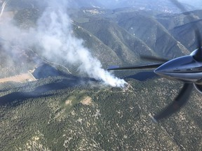 The BC Wildfire Service says crews are tackling a ground fire outside of Lillooet, B.C., that they suspect was human caused, adding to dozens of blazes sparked by recent thunderstorms. Smoke rises from a ground fire near Lillooet, B.C., in an undated handout photo published to social media.