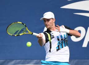 Miomir Kecmanovic of Serbia hits a forehand.