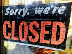 A file photo of a store closed sign.