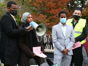 Farhia Ahmed of The Justice for Abdirahman Abdi Coalition speaks during a rally Tuesday after the verdict came out absolving an Ottawa police officer of any crime.