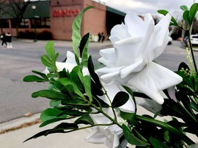 A floral memorial remains Friday near the spot where Parinaz Motahedin, 42, was struck by a vehicle and died on Oct. 10.
