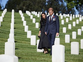 Prince Harry, Duke of Sussex and Meghan, Duchess Of Sussex lay a wreath at Los Angeles National Cemetery on Remembrance Sunday on November 8, 2020 in Los Angeles, California. PHOTO BY LEE MORGAN/HANDOUT VIA GETTY IMAGES.