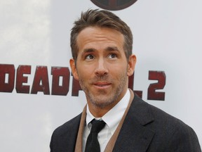 """Actor Ryan Reynolds poses on the red carpet during the premiere of """"Deadpool 2"""" in New York, in 2018."""