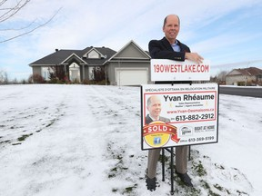 Real estate agent Yvan Rhéaume poses for a photo at 190 West Lake Circle. The home sold for $1.2 million, about $250,000 over the initial asking price.