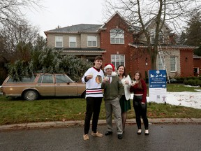Shawn Turcotte, his wife Chantelle and kids Hudson and Kennedy pose for a photo outside their home. The Turcottes have gone all out this Christmas with a National Lampoon Christmas Vacation themed display.
