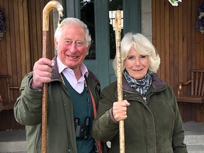 This handout image shows the 2020 Christmas card of Prince Charles, Prince of Wales and Camilla, Duchess of Cornwall, taken in the early autumn at Birkhall, Scotland.