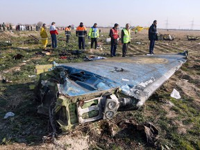 In this photo taken on Jan. 8, 2020, rescue teams are seen at the scene of a Ukrainian airliner that crashed shortly after take-off near Imam Khomeini airport in the Iranian capital Tehran. The Iranians reluctantly admitted they had shot it down. (Photo by Akbar TAVAKOLI / IRNA / AFP)