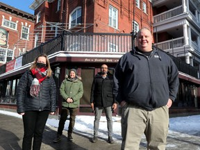 The Whalesbone restaurant group Peter McCallum (right), Jean Watson, Michael Radford and Craig Sasso in front of the old Fox and Feather pub on Elgin in Ottawa Wednesday Jan 20, 2021. The group is turning the old pub into a high-end steakhouse, which they hope will open July 1.