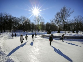 Skaters cast long shadows on sunny winter day at the rink on Mount Royal in February 2021.