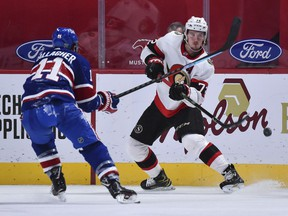 File photo/ Thomas Chabot #72 of the Ottawa Senators plays the puck past Brendan Gallagher #11 of the Montreal Canadiens during the third period at the Bell Centre on February 4, 2021 in Montreal, Canada.  The Ottawa Senators defeated the Montreal Canadiens 3-2.