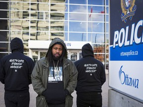 Rapper City Fidelia, seen here outside of the Ottawa Police Service's Elgin Street police headquarters, is releasing a new song called Drugs and Loaded Weapons that illustrates the tension between young Black men and the police.
