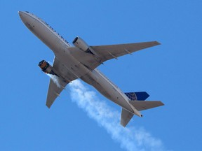United Airlines flight UA328, carrying 231 passengers and 10 crew on board, returns to Denver International Airport with its starboard engine on fire after it called a Mayday alert, over Denver, Colorado, U.S. February 20, 2021.