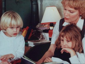 Mia Farrow with her children Ronan, left, and Dylan, right.