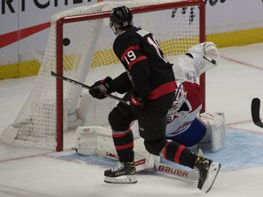 Montreal Canadiens goalie Jake Allen (34) makes a save on a shot from Ottawa Senators right wing Drake Batherson (19) in the third period at the Canadian Tire Centre.