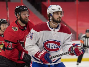 file photo/ Ottawa Senators center Derek Stepan (left) and Montreal Canadiens center Phillip Danault  follow the puck in the first period at the Canadian Tire Centre, Feb. 6, 2021.