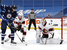 Senators goalie Matt Murray, right, in action during the Feb. 11 game against the Jets. He left that contest after two periods because of a neck strain.