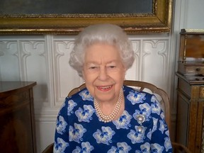 In this handout photo provided by Buckingham Palace, Her Majesty Queen Elizabeth II speaks on a video call to thank volunteers with the Royal Voluntary Service on March 19, 2021 in Windsor, United Kingdom.