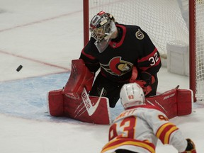 Ottawa Senators goalie Filip Gustavsson makes a save on a shot from Calgary Flames center Sam Bennett in the third period at the Canadian Tire Centre, March 22, 2021.