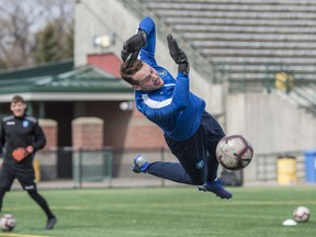 Files: Goalkeeper Dylon Powley practicing with a teammate at a FC Edmonton practice in May, 2019.