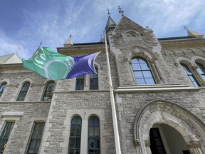 The city flag flies at half staff on City Hall in honour of Prince Philip, the Duke of Edinburgh and husband of Queen Elizabeth, who died today at 99. Errol McGihon/Postmedia