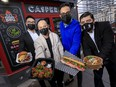 Casper Kitchen Co. partners David Wen, Nara Sok, Sharif Virani, and Ulises Ortega show off a variety of food available from their brands Old's BBQ, Viet Fresh, Banh Mi Bros, and Fried Chicken for the Seoul.