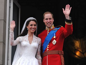 Prince William and his wife Catherine, Duchess of Cambridge, wave to the crowd from the balcony of Buckingham Palace in London on April 29, 2011, following their wedding.