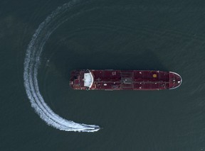 An aerial view shows a speedboat of Iran's Revolutionary Guard moving around the British-flagged oil tanker Stena Impero which was seized in the Strait of Hormuz on Friday by the Guard, in the Iranian port of Bandar Abbas in 2019. Iran and the West has been at odds for years, but the revival of the nuclear deal could cool tensions.