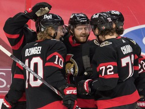 Ottawa Senators center Chris Tierney (71) celebrates with team his goal scored in the second period against the Vancouver Canucks at the Canadian Tire Centre.