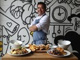 Chef Lizardo Becerra of Raphael Express with some of his dishes at his restaurant in Ottawa Wednesday.