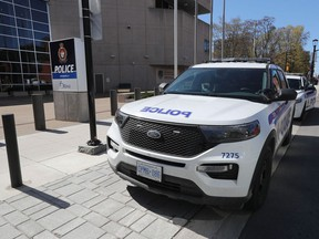 Ottawa Police Service cruisers parked beside the headquarters at 474 Elgin St.