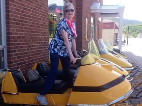 Carmelita Aubert, then 87, poses with a Ski-Doo on Canada Day two years ago.